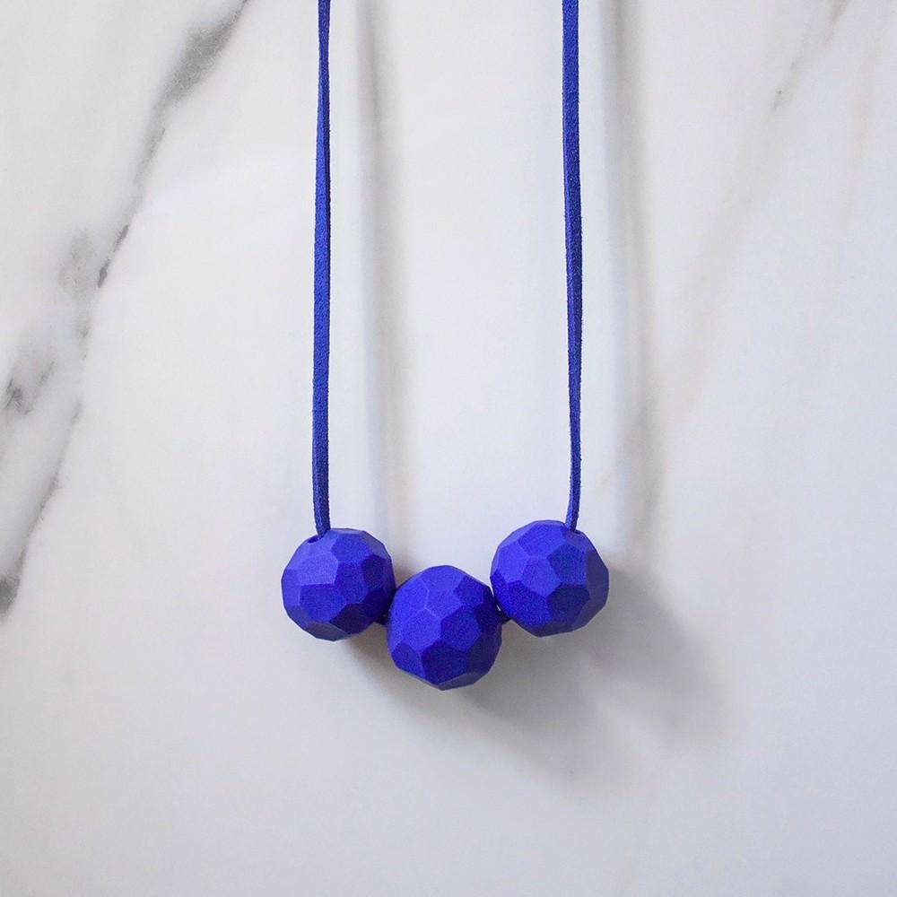 Снимка на Колие солиден цвят Peacock 'Builder'